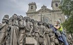 Craig Schulz, exposed a statue called Angels Unaware, as they placed it near the steps of the Basilica of St. Mary, Friday, July 30, 3021 in downtown