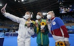 A very 2021 moment: masks, selfies and some impromptu bonding. From left gold medallist Suni Lee of St. Paul, Brazil's Rebeca Andrade and Russian An