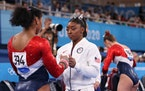 Simone Biles talks with Jordan Chiles during the Women's Team Final at the Tokyo 2020 Olympic Games