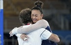 Suni Lee hugging her coach Jess Graba after her uneven bars routine in the women's all-around competition.