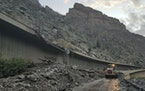 In this photo provided by the Colorado Department of Transportation, equipment works to clear mud and debris from a mudslide on Interstate-70 through