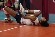 Jordan Thompson lies on the court after an injury during the women's volleyball preliminary round pool B match between United States and Russian Oly