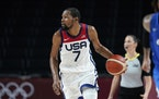 The United States' Kevin Durant (7) drives up court during a men's basketball preliminary round game against the Czech Republic at the 2020 Summer