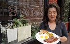 Jeannie Kim holds her popular bacon and eggs breakfast at her restaurant in San Francisco on Friday, July 30, 2021. Thanks to a reworked menu and long