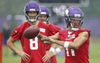 Vikings quarterbacks Kellen Mond, right, and Kirk Cousins.