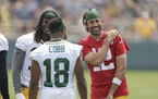 Aaron Rodgers shares a laugh with wide receivers Davante Adams and Randall Cobb on Saturday.