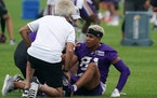 Vikings receiver Bisi Johnson was helped by trainers in practice Friday.