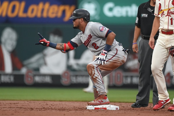 Minnesota Twins' Luis Arraez reacts after hitting an RBI-double during the third inning