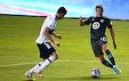 Minnesota United midfielder Robin Lod, right, vies for the ball with Vancouver Whitecaps defender Ranko Veselinovic