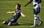 Minnesota United midfielder Ethan Finlay reacts after being called for a foul in the penalty area late in the second half