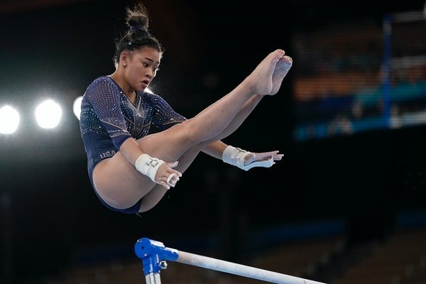 Sunisa Lee of the United States, performs on the uneven bars during the artistic gymnastics women's apparatus final at the 2020 Summer Olympics, Sunda
