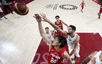 Japan's Daiki Tanaka (24) fights for a rebound with Argentina's Leandro Bolmaro (10) on Sunday at the Olympics.