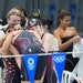 Team USA swimmers Regan Smith, Lydia Jacoby, Torri Huske and Abbey Weitzeil huddled after swimming to silver in the women's 4x 100 meter medley rela