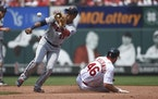 The Cardinals' Paul Goldschmidt stole second base as Twins second baseman Jorge Polanco tried to tag him in the third inning of St. Louis' 7-3 vic