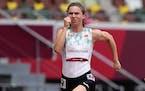 Krystsina Tsimanouskaya, of Belarus, runs in the women's 100-meter run at the 2020 Summer Olympics, Friday, July 30, 2021. Tsimanouskaya alleged her