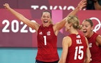 The United States' Micha Hancock celebrated with teammates after beating Italy 21-25, 25-16, 25-27, 25-16, 15-12 in a women's volleyball prelimina