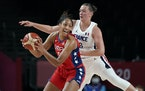 A'ja Wilson (left) passed ahead of France's Alexia Chartereau during a women's basketball preliminary round game Monday in Saitama, Japan. Wilso