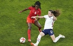 Canada's Deanne Rose, left, and United States' Tierna Davidson battle for the ball during a women's semifinal soccer match at the 2020 Summer Ol