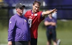 Minnesota Vikings head coach Mike Zimmer left and  quarterback Kirk Cousins (8) went over a play during Minnesota Vikings training camp at TCO Perform