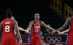 Sylvia Fowles (13) of the Lynx celebrates with teammates after scoring during Monday's game against France.