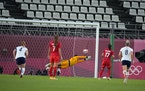 Jessie Fleming of Canada (17) scores past goalkeeper Adrianna Franch of the United States during their semifinal match.