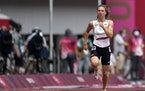 Krystsina Tsimanouskaya, of Belarus, runs in the women's 100-meter run at the Olympics on July 30.