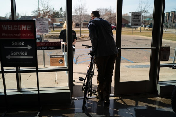 Kyle Williams of Minneapolis walked out of Erik's Bike Shop in Richfield, Minn., with a new bicycle on Friday, March 26, 2021.