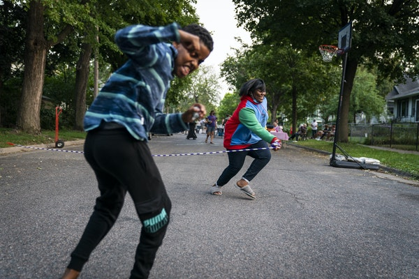Mohamed Ali, left, 13, played a game called helicopter with Chaniyla Greene, 13, a couple of blocks from George Floyd Square at last year's National