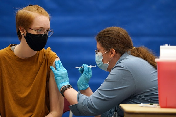 Chloe Archer got the Pfizer vaccine from pharmacist Karla Marz during a free COVID-19 vaccination event at Hamline University in May.