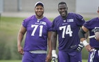 Vikings offenseive linemen Christian Darrisaw, left, and Oli Udoh.