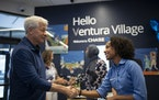 JPMorgan Chase CEO Jamie Dimon said hello Monday to Tsedenya Mengiste, a personal banker at Chase's Ventura Village branch on East Franklin Ave.