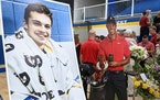 A cardboard cutout of Tiger Woods stood beside Mack Motzko's picture at his celebration of life ceremony Monday, Aug. 2, 2021 in St. Cloud. The fami