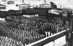 This undated file photo shows a roll call, in the early morning or late evening hours, on the roll call square in front of the camp gate of the Nazi c