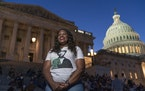 Rep. Cori Bush, D-Mo., speaks with reporters as she camps outside the U.S. Capitol, in Washington, Monday, Aug. 2, 2021, as anger and frustration has