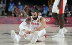 Spain's Ricky Rubio (9) reacts after he fell on the court during men's basketball quarterfinal game against United States of America at the 2020 Summe