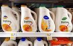 Bottles of PepsiCo Inc. Tropicana orange juice are displayed for sale.