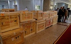 Boxes containing recovered looted artifacts sit temporarily at the foreign ministry before being transferred to the Iraq Museum, in Baghdad, Iraq, Tue