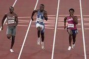 Hopkins' Joe Fahnbulleh (center), running for Liberia, finished second in a men's 200-meter semifinal. just behind Aaron Brown of Canada (left) an