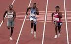 Aaron Brown, of Canada, Joseph Fahnbulleh, of Liberia and Noah Lyles, of United States race in a men's 200-meter semifinal.