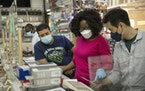 Employees wore masks at an electronics store in Manhattan on July 28, 2021.