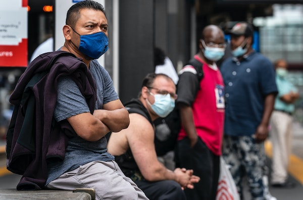 People waited to board light rail at the Nicollet Mall station Monday. Announcements about new mask or vaccine requirements have emerged across Minnes