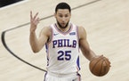 Sixers guard Ben Simmons raises his fingers while dribbling the basketball against Atlanta Hawks in Game 6 of the NBA Eastern Conference playoff semif