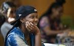 Sanaa Wilder listened to a folk tale told by storyteller Vusumuzi Zulu.