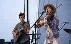 Vocalist and fiddle player Ketch Secor with guitarist Mason Via early in Old Crow Medicine Show's Canterbury Park performance.