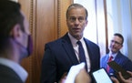 Senate Minority Whip John Thune, R-S.D., talks to reporters outside his office as the Senate works to advance the $1 trillion bipartisan infrastructur