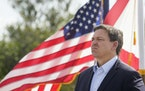 Florida Gov. Ron DeSantis listens during a news conference, Tuesday, Aug. 3, 2021, near the Shark Valley Visitor Center in Miami.