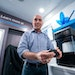 Stratasys CEO Yoav Zeif in the company's mobile showroom in Eden Prairie with the new MakerBot Method X machine.