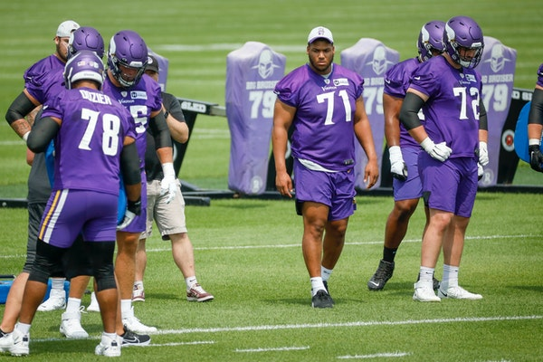 First-round draft Christian Darrisaw (71) watched drills last week.