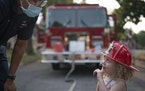 St. Paul firefighter Christyn Lewis talked with Audrey Safar, 3, during a visit at National Night Out hosted by The House of Hope Presbyterian Church