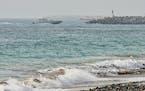 "An Emirati Coast Guard vessel patrols off Fujairah, United Arab Emirates, Wednesday, Aug. 4, 2021. The British navy warned of a ""potential hijack"""